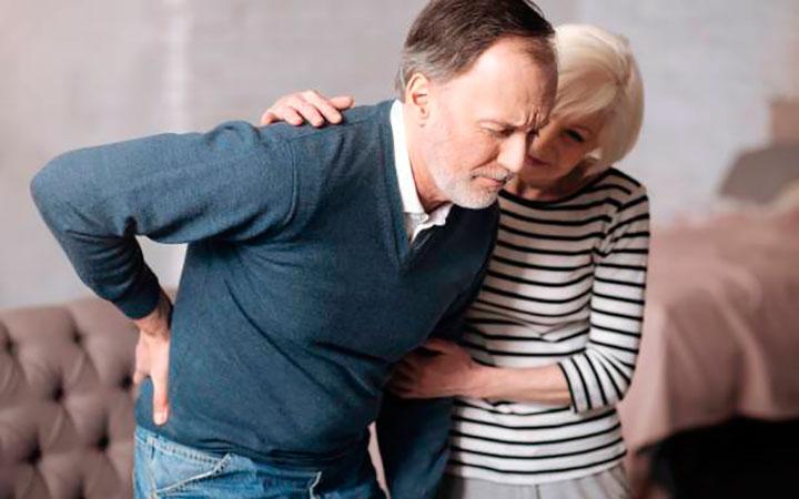 Поясничная боль - один из симптомов рака простаты